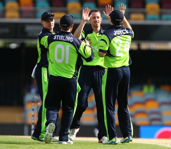 Alex Cusack celebrates with his team after getting the wicket of Rohan Mustafa