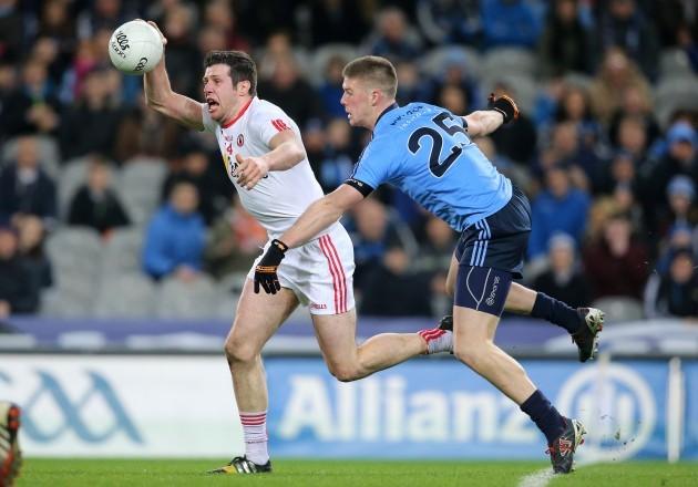Shane Carthy tackles Sean Cavanagh