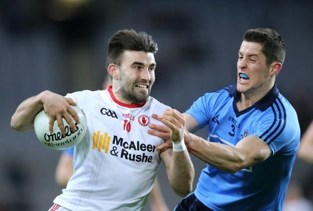 Rory OÕCarroll tackles Tiernan McCann