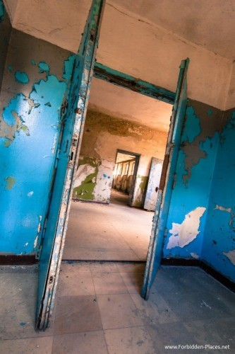 the-changing-rooms-once-painted-in-electric-shades-of-blue-and-olive-have-since-decayed