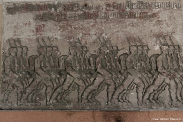 in-the-amphitheater-a-base-relief-sculpture-by-german-artist-walter-von-ruckteschell-depicts-german-troops-marching