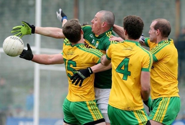 Kerry's Kieran Donaghy under pressure from the Donegal defence
