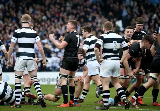 Mattie Keane celebrates as Dan Trayers scores a try
