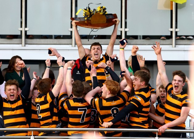 Lewis McNamara lifts the cup