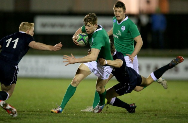 Garry Ringrose tackled by Ben Rogers and Alec Coombes