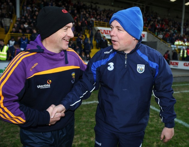 Liam Dunne and Derek McGrath shake hands after the game
