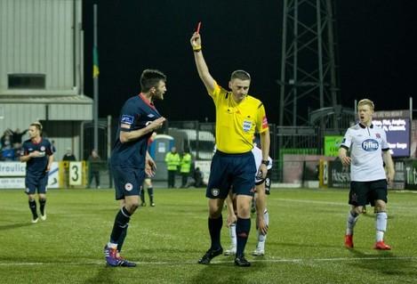Killian Brennan is shown a red card by Paul McLaughlin