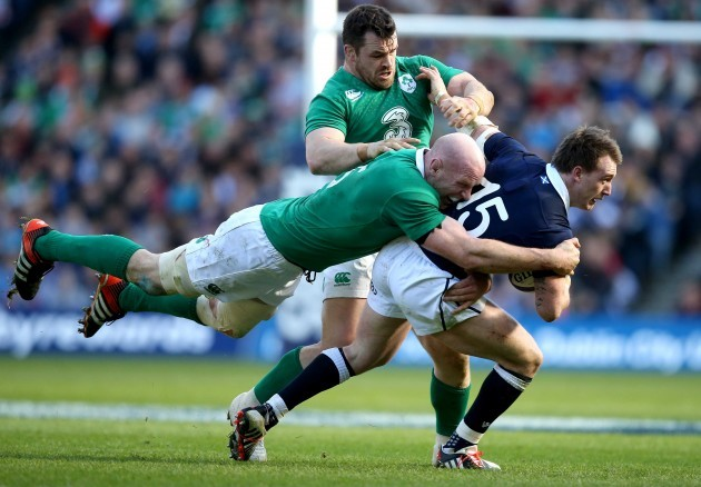 Paul O'Connell and Cian Healy tackle Stuart Hogg