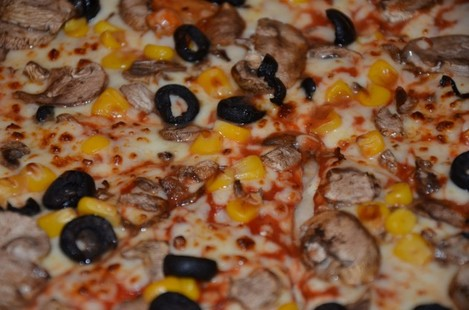 Mushroom, sweetcorn and olive Double Decadence Domino's pizza