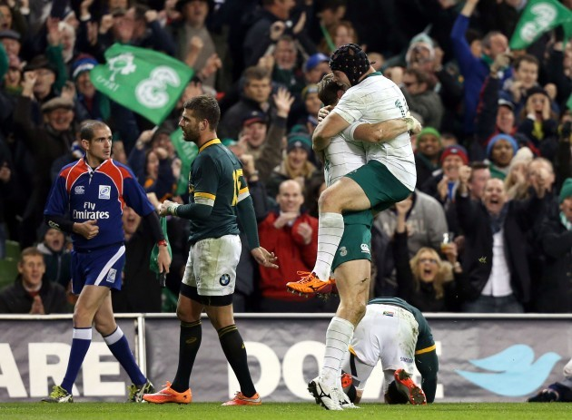 Tommy Bowe celebrates his try with Richardt Strauss