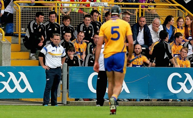 Davy Fitzgerald looks on as Brendan Bugler leaves the field after being sent off