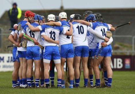The Waterford team huddle before the game