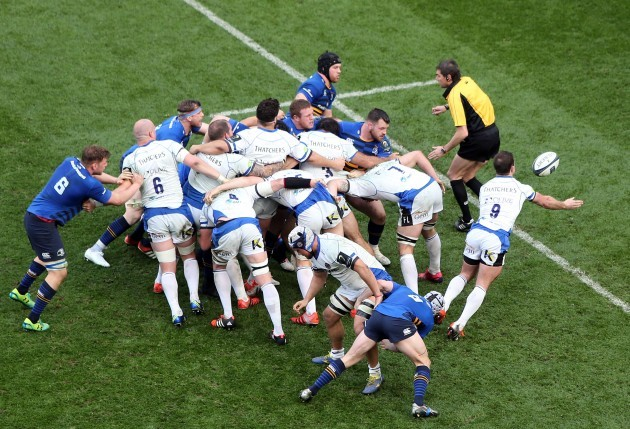 Micky Young passes the ball from a scrum