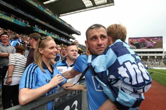 Alan Brogan with his wife Lydia and son Jamie after the game