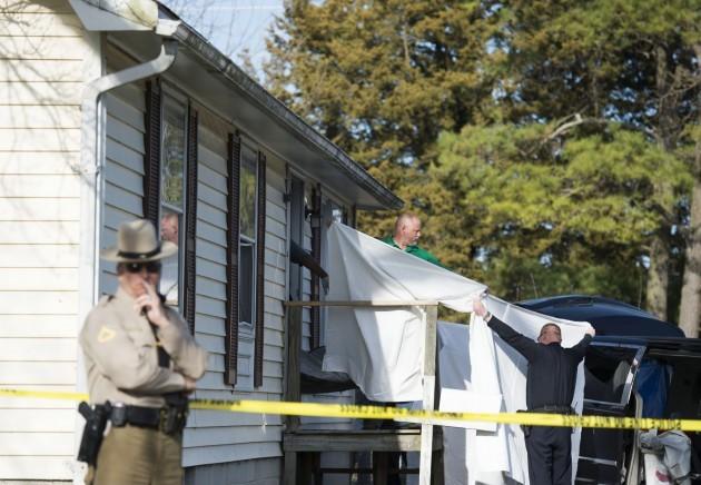 APTOPIX Eight Dead In Home