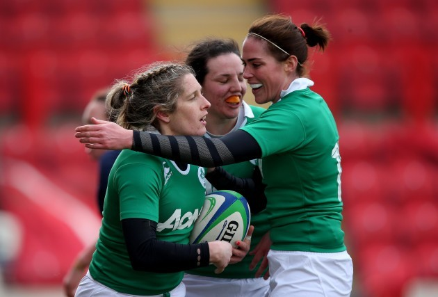 Alison Miller celebrates her try with Nora Stapleton and Paul Fitzpatrick