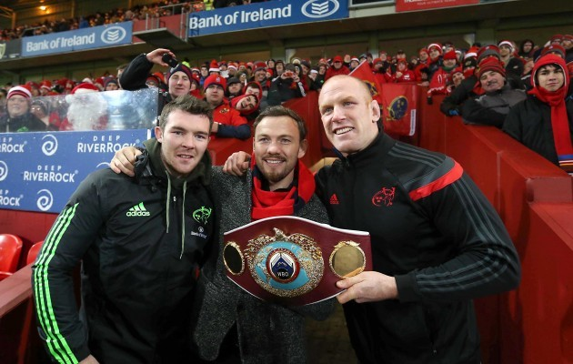 Andy Lee shows his belt off to the Munster fans at Halftime with Peter O'Mahony and Paul O'Connell