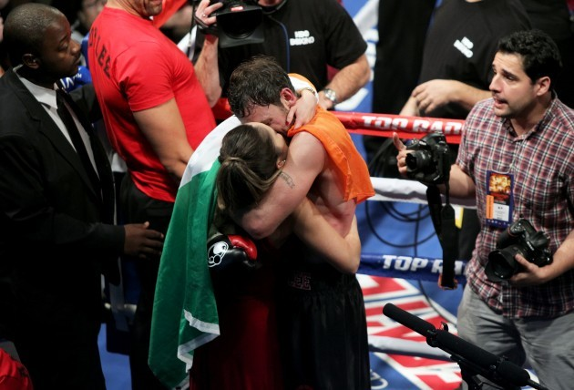 Andy Lee celebrates winning with his wife
