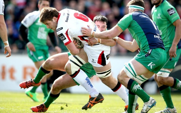 Denis Buckley and Eoghan Masterson tackle Iain Henderson