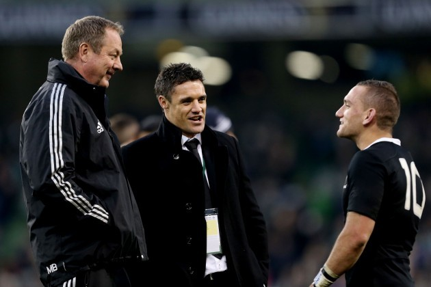Mike Byrne and Dan Carter speak with Aaron Cruden after the game