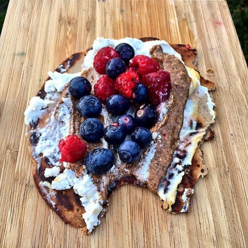 Devine evening treat buckwheat pancake smeared with coconut yogurt, almond butter and berries!