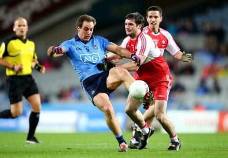 Tomas Brady under pressure from Oisin Duffy