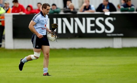 Tomas Brady leaves the field with an injury