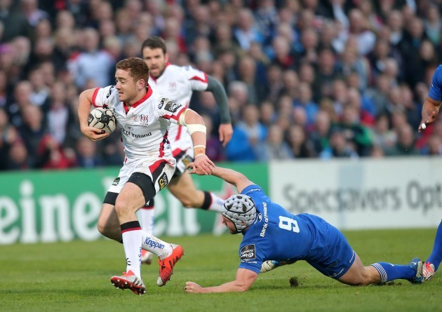 Paddy Jackson is tackled by Isaac Boss