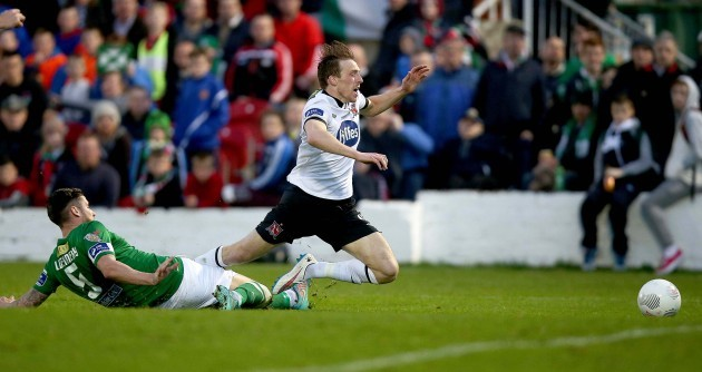 David McMillan is brought down for a penalty by Darren Dennehy