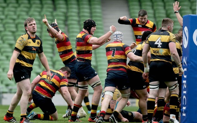 Lansdowne players celebrate scoring a try in the last seconds of extra time
