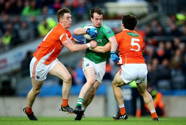 Ciaran OÕHanlon and James Morgan tackle Ruairi Corrigan