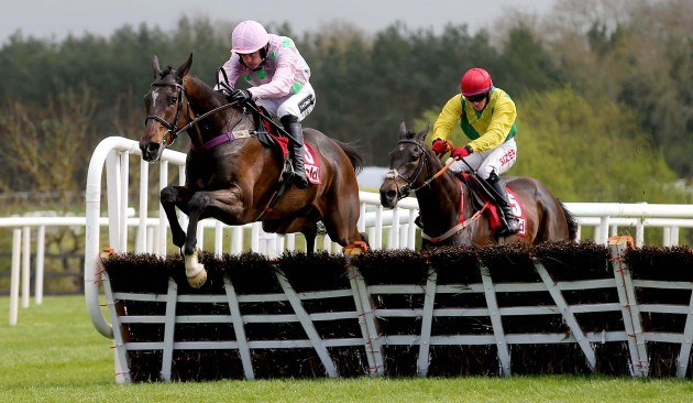 Douvan ridden by Ruby Walsh clears the last fence on the way to winning