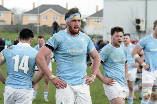 Garryowen players dejected after the game