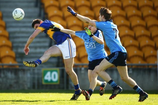 Colin O'Riordan under pressure from Eoin Murchan and Ross McGowan