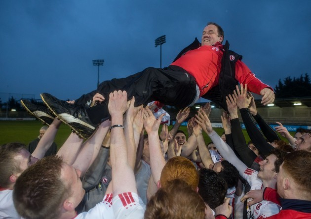 Tyrone players celebrate with Feargal Logan