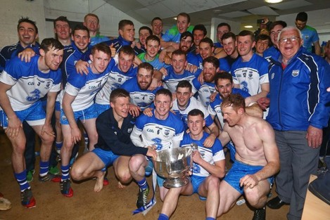 Waterford players celebrate with the cup