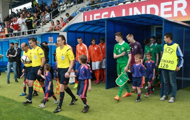 The two teams make their way out to start the game