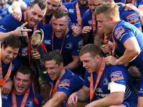 Jamie Heaslip with the trophy and teammates at the end of the match