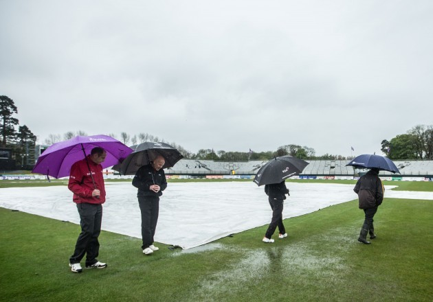 The umpires perform a pitch inspection