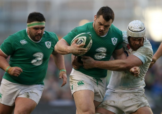 Cian Healy tackled by Dave Attwood