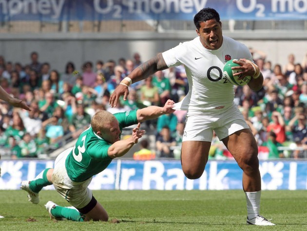 Keith Earls can't hold Manu Tuilagi as he runs in to score a try