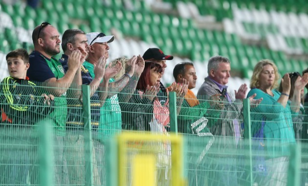 Ireland fans applaud their team after the game