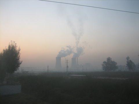Smoking factories along China rail road