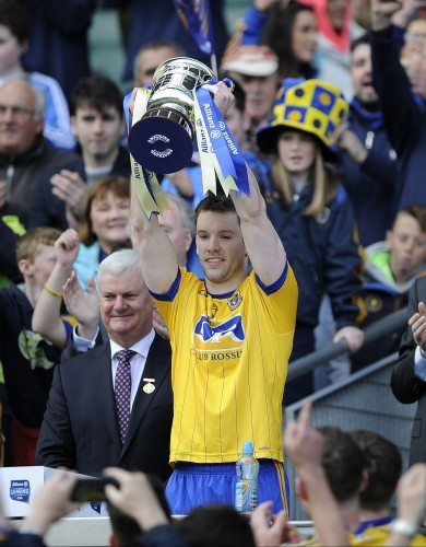 Niall Carty lifts the cup