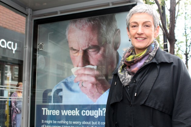 Dr Miriam McCarthy, Consultant at the Public Health Agency (PHA), at one of the PHA's 'coughing' bus shelters in Belfast. The innovative shelters are designed to grab the attention of passengers and raise awareness of lung cancer. The initiative is part of the PHA's 'Be Cancer Aware' campaign and there are five such shelters in Belfast and Derry/ Londonderry