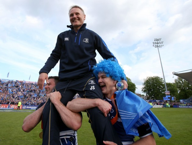 Fergus McFadden and Jonathan Sexton celebrate with Joe Schmidt