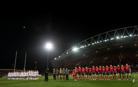 The Ulster and Munster teams observe a minute's silence in memory of Jack Kyle and David McCormick