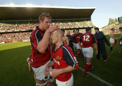 Paul O'Connell and Peter Stringer celebrate
