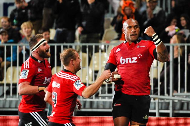 Nemani Nadolo celebrates his try with Andy Ellis and Kieran Read