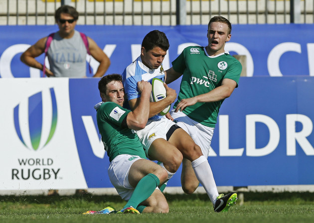 Lautaro Velez tackled by Billy Dardis and Nick McCarthy